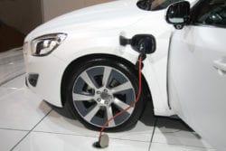 white hybrid car on recharge